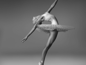 Ballerina in a tutu and pointe shoes makes a beautiful pose. Black and white photo