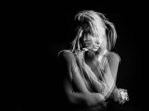 Emotional dreamy woman portrait triple Multiple exposure black and white photo