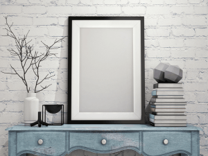 mock up poster frame with on vintage chest of drawers