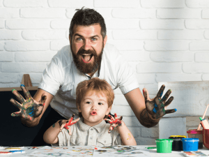 Joy family art, happy father and son show hands in bright colors