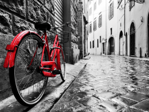 Retro vintage red bike on cobblestone street in the old town