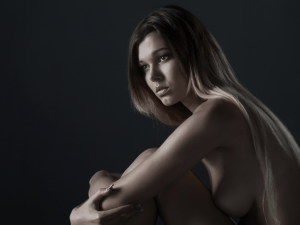 Beautiful naked woman on a black background