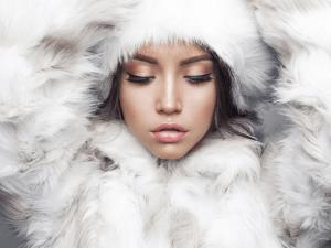 Fashion studio portrait of beautiful lady in white