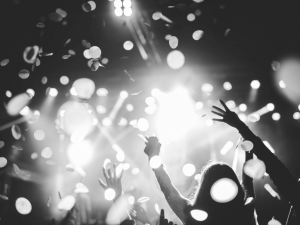 Black and white photo of a festival crowd rising their hands