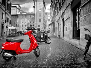 Small red motorbike on roman street