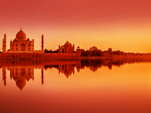 Panoramic view of Taj Mahal during sunset reflected