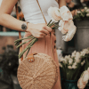 Blogger girl holding a bunch of flowers