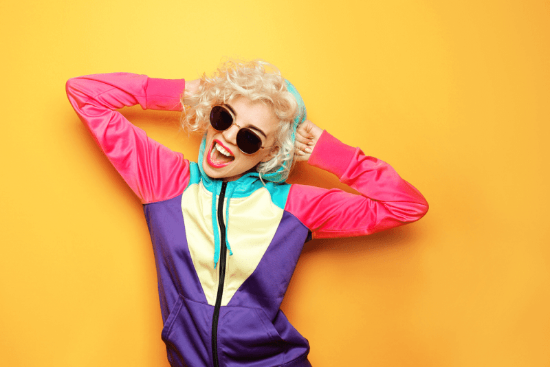 Fashion girl in sportswear on yellow background